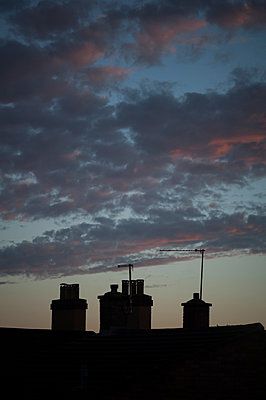 Chimney pots at dusk - p1047m1055609 by Sally Mundy