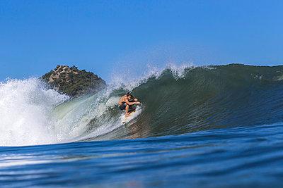 Man surfing on wave - p1108m1137960 by trubavin