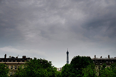 Eiffel Tower in the distance over Paris buildings, France - p1072m829274 by Neville Mountford-Hoare