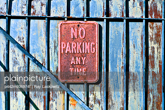 Louisiana, New Orleans, No Parking sign on gated fence. - p442m936974f by Ray Laskowitz