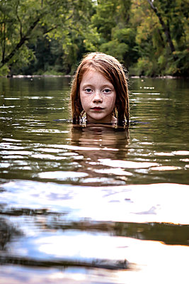 Girl bathing in the creek - p1019m2124774 by Stephen Carroll