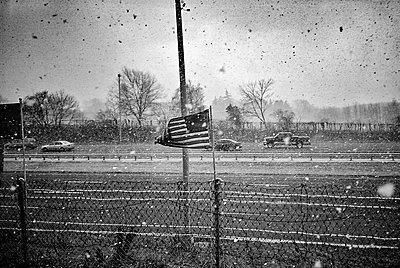 American flag against highway - p1484m2150262 by Céline Nieszawer