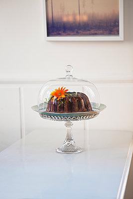 Chocolate cake on table - p352m1100360f by John Sandlund
