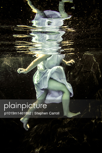 Child floating underwater - p1019m1461892 by Stephen Carroll