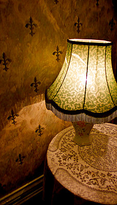 Atmospheric lamp next to a wall - p1072m829525 by Tracy Jean Shields