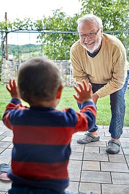 Grandfather meets grandson - p1146m2187865 by Stephanie Uhlenbrock