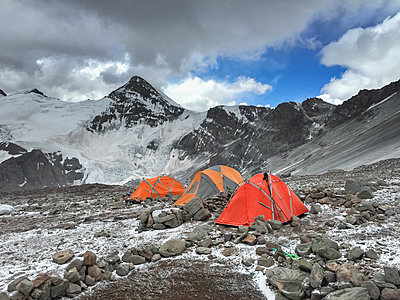 Orange tents vs blue sky - p1166m2202309 by Suzanne Stroeer