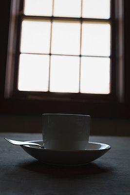 Teacup on Table by Window - p1331m1195737 by Margie Hurwich