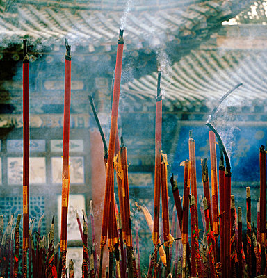 Incense sticks burning at Buddhist Temple, Silk Route; Dunhuang, Jiuquan, Gansu Province, China. - p429m802634 by Cultura