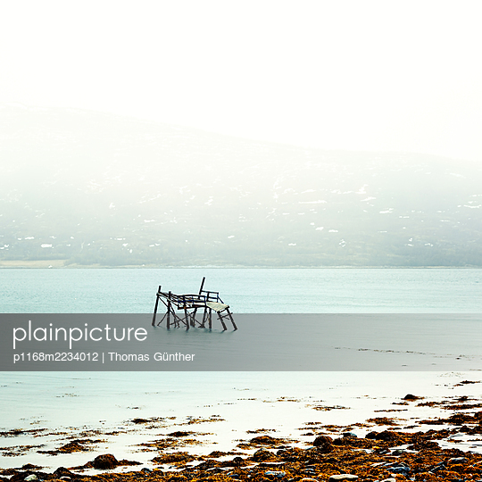 Norway, Troms, Broken jetty - p1168m2234012 by Thomas Günther