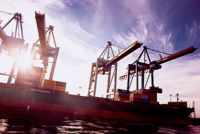 Building cranes in a harboure. - p312m672781 by Bruno Ehrs