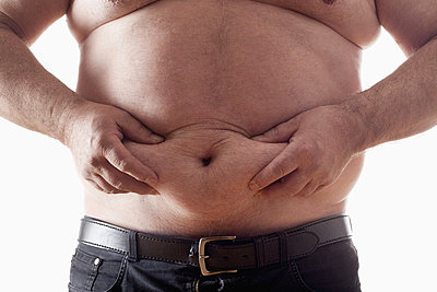 big belly of a fat man isolated on white - p4551512f by Frank Chmura