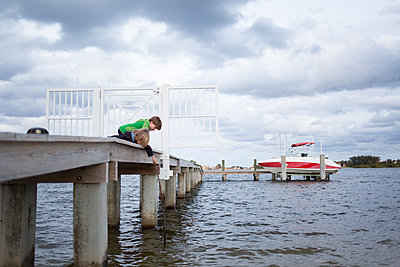 Kids by the water on the pier - p1308m2065266 by felice douglas