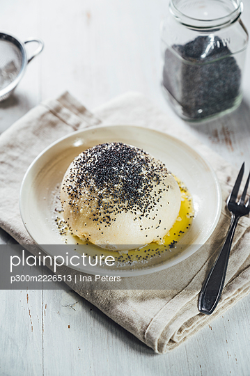 Sweet Germknodel dumpling with poppy seeds - p300m2226513 by Ina Peters