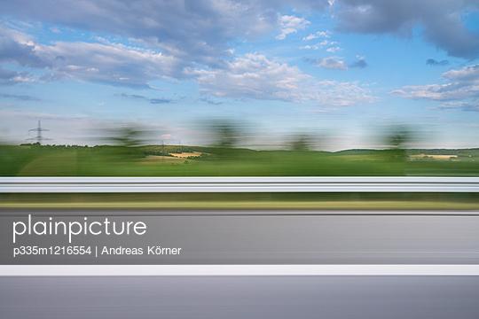 Motorway driving - p335m1216554 by Andreas Körner