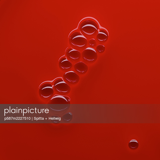 Bubbles on red - p587m2227510 by Spitta + Hellwig