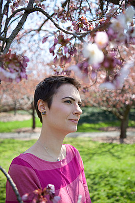 Woman among cherry blossoms - p5070101 by Lauren Krohn