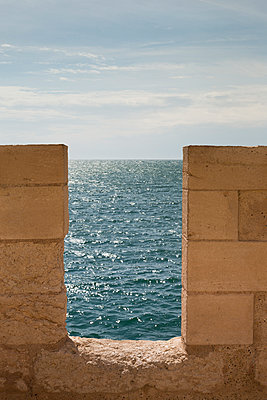 Stone wall and sea - p445m1153175 by Marie Docher