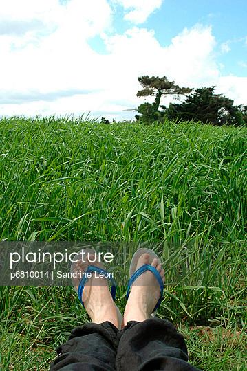 Feet and flip flops - p6810014 by Sandrine Léon