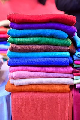 Pile of colourful wool scarves - p1048m2035819 by Mark Wagner
