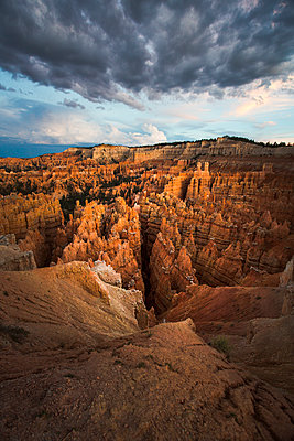 Dramatic sunset after a passing storm over the abstract rock formations at Bryce Canyon National Park - p1057m1466789 by Stephen Shepherd