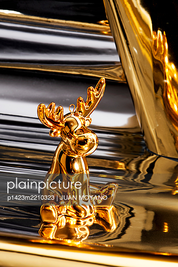 Golden reindeer in a silver and golden background - p1423m2210323 by JUAN MOYANO