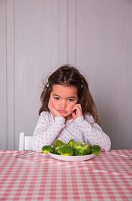 Girl dislikes vegetables - p1231m1209059 by Iris Loonen