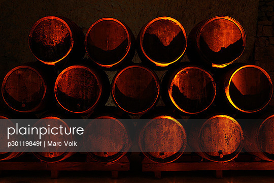 Stack of oak barrels of champagne - p30119849f by Marc Volk