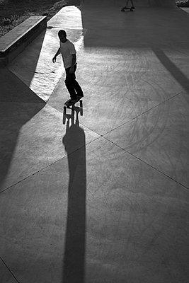 Skateboarder & shadow - p1201m1050385 by Paul Abbitt
