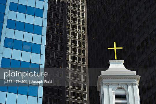Cross and skyscrapers - p378m794921 by Joseph Reid