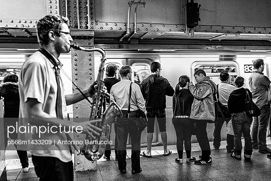 United States;  USA;  New York City;  Musician in the subway - p566m1433209 by Antonino Bartuccio