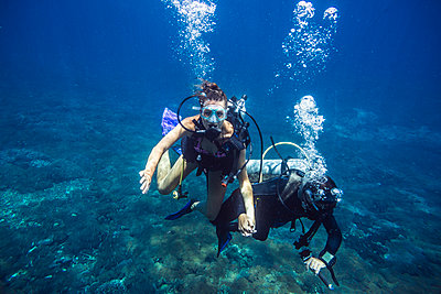 Divers in Indian ocean - p1108m1118849 by trubavin