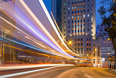 Trams passing Bank of China Building and HSBC Building, Central, Hong Kong, China - p651m2006472 by Ian Trower