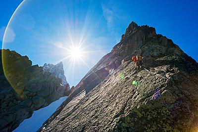 Europe, France, Haute Savoie, Rhone Alps, Chamonix Valley, rock climber on Aiguille de l'M - p651m1005710 by Christian Kober