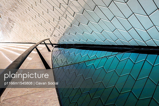 Reflection of wall on glass at MAAT - p1166m1545808 by Cavan Social