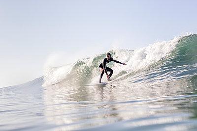 Man surfing in sea against clear sky - p1166m1546085 by Cavan Social