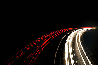 Headlights and tail lights on motorway - p92411545f by James French