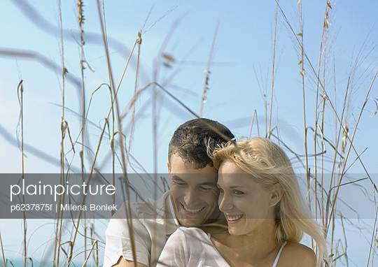 Couple embracing in dune grass