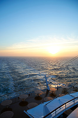 Sea voyage at sunrise - p851m1048607 by Lohfink