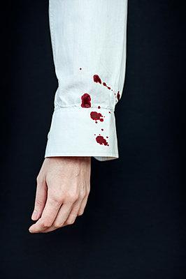 Blood drops on sleeve - p971m1054849 by Reilika Landen