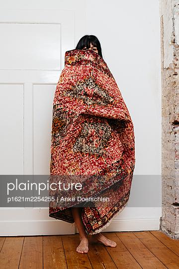 Standing woman in carpet - p1621m2254255 by Anke Doerschlen