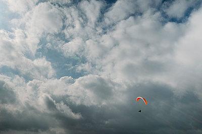 Paraglider against sky - p1166m2201454 by Daniel Santacatalina