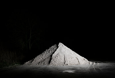 Heap of sand in the dark - p1132m2126163 by Mischa Keijser
