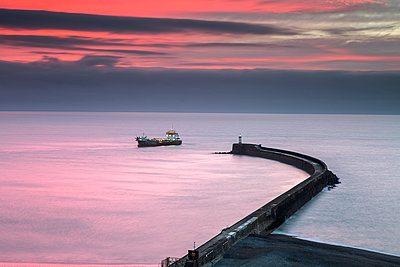 Fishing boat at sunrise, Newhaven, England - p1516m2158257 by Philip Bedford