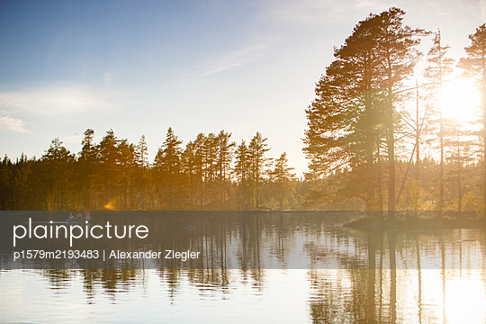 Sweden, Rowing boat excursion on a lake - p1579m2193483 by Alexander Ziegler