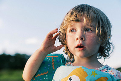 A little girl by the water listening to the sounds of nature - p1166m2202042 by Cavan Images
