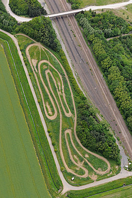 Curvy rural racetrack - p1048m1182448 by Mark Wagner