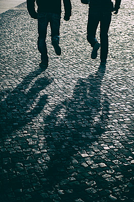 Two men running away in the dark  - p794m1538286 by Mohamad Itani