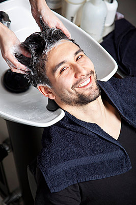 A man having his hair washed at a hair salon - p30119267f by Marco Baass