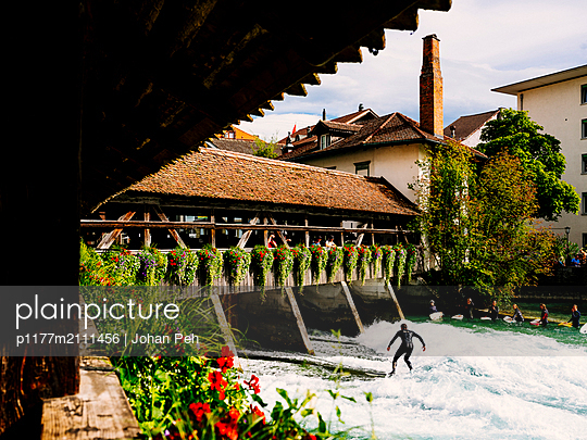 River surfing - p1177m2111456 by Philip Frowein